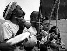 220px-Capoeira-three-berimbau-one-pandeiro