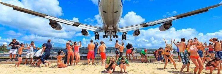 Flugzeug maho Strand